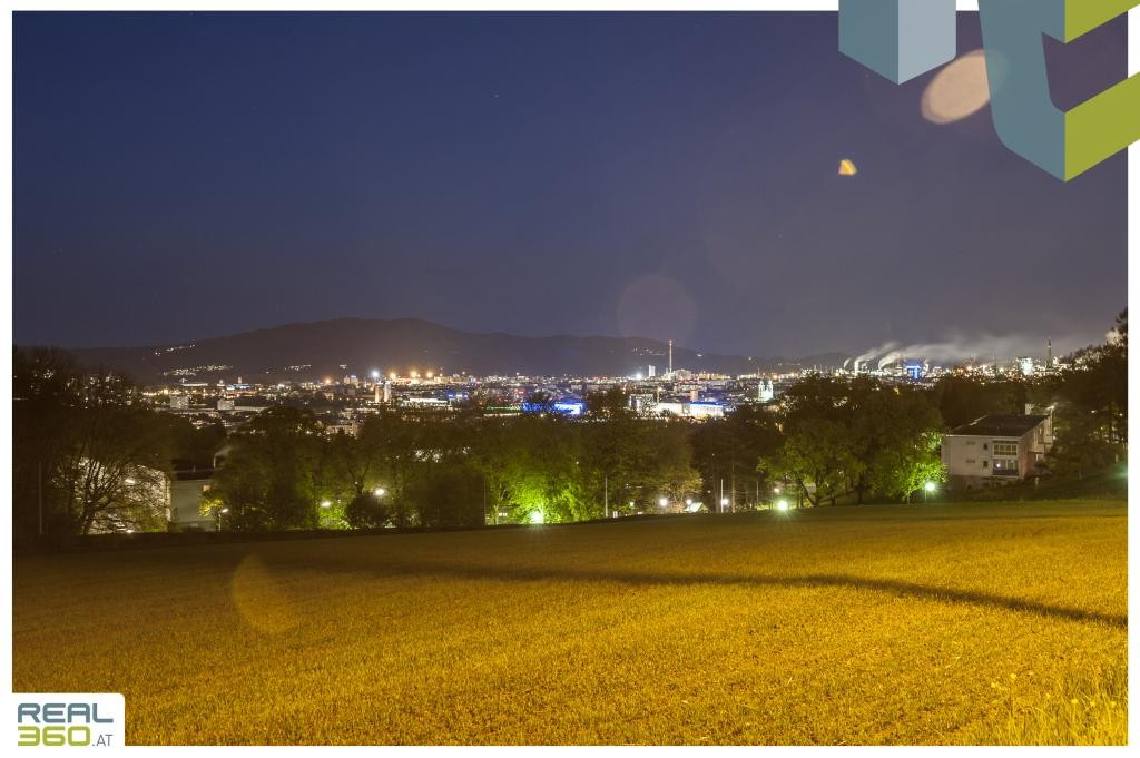 Blick auf die Lichter der Stadt Linz