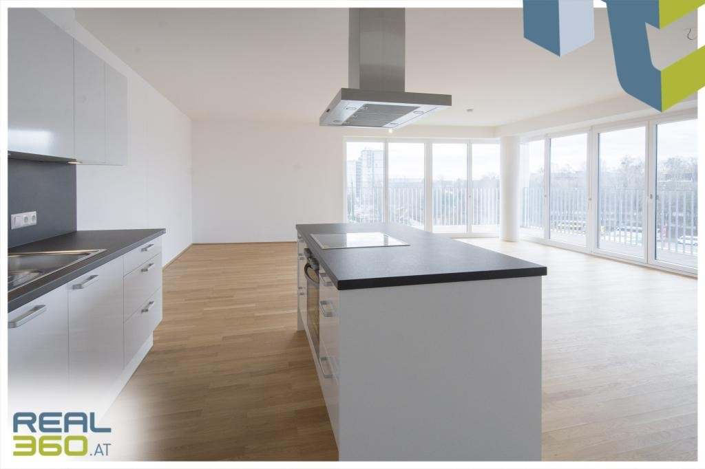 Küche/Wohn/Essbereich mit TerrassenzugangI
